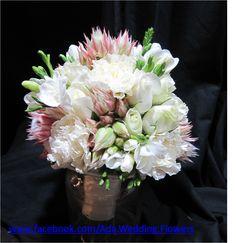 blushing bride, rose, carnations and freesia