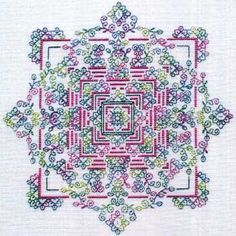 Stitch this colorful Blackwork garden in silk. We suggest stitching it on 28-count White Cashel linen (3281-100). The model was stitched with Dinky-Dyes silk