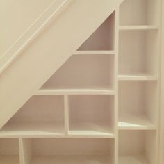 My under stairs book/shoe shelves. Optimises the storage as there is still cupboard space behind.