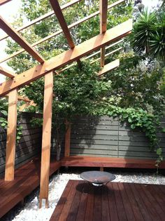 View of corner bench and cantilevered trellis with Ipe deck and white rocks