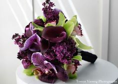 Different variety of the vanda orchid, along with richly colored lilac, plum calla lilies, aubergine parrot tulips, and chartreuse cymbidium orchids.  Source: http://www.eventtrender.com/blog/2011/05/a-punch-of-purple-floral-bouquets-by-aileen-tran.html#