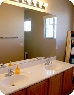 Frame Your Bathroom Mirror Over Plastic Clips