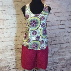 100% RAYON BOLD PRINT BLOUSE This has a bold print and vibrant colors with a beautiful detailed back.  JUNIOR SIZING Unionbay Tops Blouses