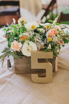 Gold table numbers and pretty peach #centerpieces #wedding #ceremony