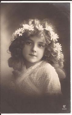 Edwardian girl, ca. 1910. (real photo postcard)