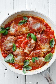 Prosciutto wrapped chicken breast in sautéed tomatoes sauce