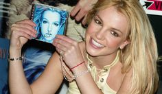 Britney Spears signs her new CD, In The Zone, at Virgin Megastore in Times Square in New York City in 2003.  | THE X FACTOR on FOX