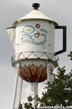 Stanton proudly rehydrates from two water towers, a Swedish coffee pot and a cup, to celebrate its natives' native land and a hometown heroine who starred in Folgers TV commercials.