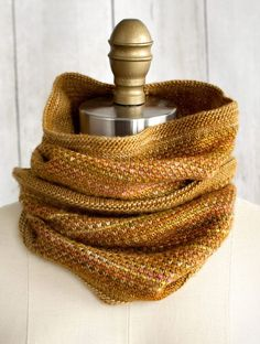 Free Knitting Pattern for 2 Row Repeat Tejido Cowl - This gorgeous cowl is made with 2 colors of yarn knit in a 2 row repeat Swedish Weave Stitch. Cowl is worked flat and seamed. Fingering weight. Designed by Sarah Solomon for Fairmount Fibers.