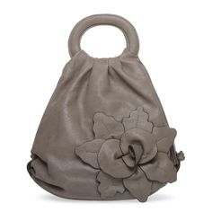 OH MY GOD! HANDS DOWN MY FAVORITE BAG I FOUND ON THIS SITE! Love the color, the unique shape of it, and most of all, the pretty flower design!