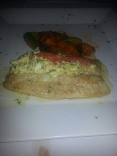 Spanish style Chilean Sea Bass with zucchini medley