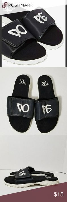"""YRU dope slides. (Used one time) YRU so dope right now? The Dope Slides are black and feature velcro closure, """"DO"""" and """"PE"""" embroidery, and treaded rubber white sole. Perfect for your summer swim gear, or teamed up with harem pants and a caged bustier top. By YRU. Synthetic materials. Shoe height: 3""""/7.5cm. Heel height: 1""""/2.5cm. True to size. Imported. Color: black YRU Shoes Slippers"""