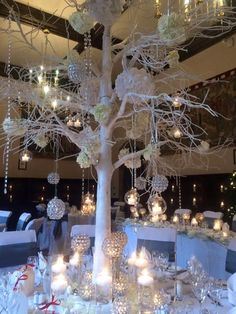 Trees are a trending centerpiece - this is the perfect one for a Winter white wedding ~ Red floral architecture