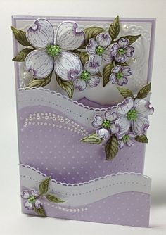 """This pastel """"Happy Spring"""" card will brighten anyone's day. The base of this card is a 6″ x 12″ white card stock. Score long side at 4″ and 8″. Fold score …"""