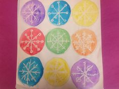 use a white crayon to make a snowflake, put watercolors over it to make the snowflake come out