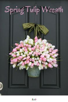I loooove this tulip wreath! It's so springy and looks so real! #ad #tulips #wreath #doorhanging #homedecor