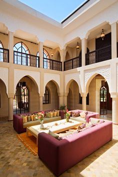 Large central atrium with retractable glass roof at Villa El Boura, Marrakech