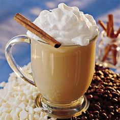 White Chocolate Latte (2 cups milk   1 cup half-and-half   2/3 cup white chocolate morsels 2 tablespoons instant coffee granules   1 teaspoon vanilla extract 1/4 teaspoon almond extract Whipped cream   Garnish: cinnamon sticks)