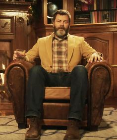 Here's Nick Offerman sitting in front of a yule log, drinking whisky, for 45 minutes. You're welcome.