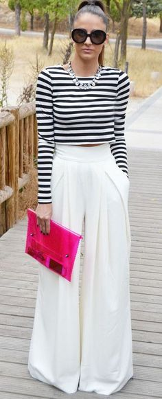 Long sleeves stripe top, white palazzo pants, sunnies, statement necklace and pink clutch. | Summer Style
