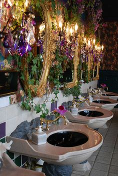 A portion of the very elegant million dollar Ladies Room at the Shoji Tabuchi Theater in Branson, MO. Fresh orchids are beside each wash basin daily. They say the Gentlemen's Room is also amazing!!!