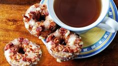 Mini donuts made with Pillsbury Grands! Jr. biscuits, topped with a maple-apple glaze and sprinkled with bacon.