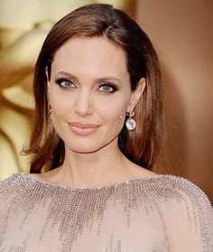 Angelina Jolie: Jolie wore her hair sleek and pushed back—one of spring's latest red carpet trends—thanks to hairstylist Adam Campbell at the 86th Annual Academy Awards. #AngelinaJolie #Oscars #RedCarpet