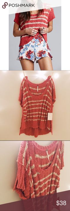 Free People Split Short Sleeve Rib Knit Sweater Free People Split Short Sleeve Rib Knit Sweater, size S, color is called washed tom which is like a bright coral. New with tag. High low hem and loose fit. Material 73% cotton, 22% nylon, 5% linen. Free People Sweaters Crew & Scoop Necks