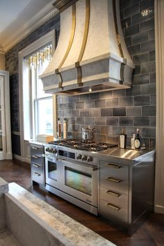 Habitually Chic®: Kips Bay Kitchen  Yes, the stove is amazing, but what I love is the dark herringbone in contrast to the stainless.