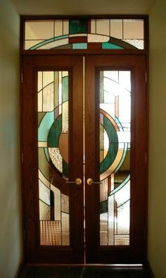 This Art Deco entryway is one of a series of art glass door panels in this contemporary styled high-rise Chicago condominium.