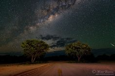 Road to the Stars - A dirt road leading into the unknown under a majestic blanket of stars in the Kalahari desert, South Africa.