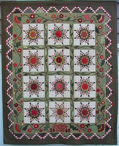 Red and green feathered stars with appliqued inner border: Piecemakers Quilt Guild, 2008 opportunity quilt