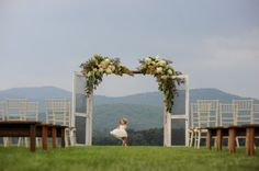 the hills are alive!!  Love the screen doors and huge swags....such a beautiful backdrop