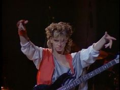 John Taylor. Summons the followers of the sexy black-leather panted bass god.