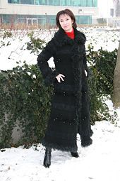 Another type of my original knit coat - here a maxi long version, in A line, with raglan, belle sleeves and big collar. This coat is made in material mix in black colour, with various types of yarns.
