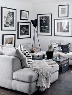 zona de sofás en blanco, gris y negro