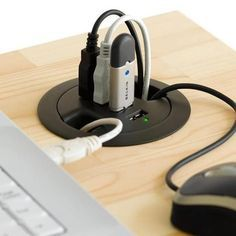 """So what to do with those random holes in a desk that come with apparently all """"professional desks"""" nowadays. Their original use to act as a port hole for cables on desktops. However they are a thing of the past now and its all about laptops. Belkin has made a usb hub that fits in those holes so that laptops have a tidy and efficient space for anything usb!"""