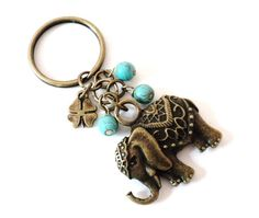 Sacred Elephant Keychain Turquoise Bag Charm Yoga Accessories Good Luck Clover Party Favors Unique Gift For Her Mothers Day Birthday. This listing is for one Sacred Elephant keychain. It features beautiful turquoise and a antique brass Sacred elephant and a clover charm. Approx measure: 3'' from top of keyring to bottom of Elephant charm ♥ The elephant is a sacred animal for many cultures and carries a great amount of symbolism. It is one of the sacred treasures of Buddha, and according…