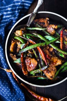 Fiery Burmese Chicken and Veggies- a fast and full-flavored, Burmese style stir-fry that can be made in 20 minutes. Vegan and Gluten-free adaptable, this meal is low in carbs. #burmesefood #burmesechicken #burmeserecipes #burma #stirfry #chicken #wok