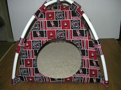 USC Gamecocks Handmade Fabric Pup Tent Pet Bed. Avail @ http://stores.sharonsdecoratedbooks.com/ Beds r made when ordered and payment is received. The average time that it takes for the Bed to ship after payment is usually 5 biz days. The Pet Beds are made of licensed cotton NCAA College material, but are not licensed by the NCAA College. They are handcrafted and resold under rights granted by the 1st sale doctrine. We are not affiliated with The Licensed Company in any way. ***22$ Sm  27$…