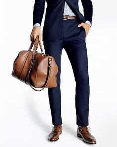 As a general rule, your belt should match your shoes. We love dark brown leather with a navy suit. www.enzocustom.com