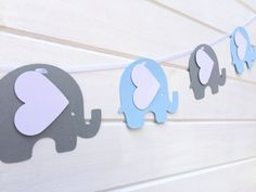 Blue & Gray Elephant Garland. Baby shower, nursery decor, high chair, birthday party, bunting, banner, dessert table. First birthday party. by MyPaperPlanet on Etsy https://www.etsy.com/listing/226144637/blue-gray-elephant-garland-baby-shower