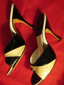 Elegant sexy 4 mules/spring-a-la-tors, in a two-tone cream and black patent leather, thats made by hand. Shoe was designed by Catalano, is in very good condition, and seems to have never been worn. No size in shoe, so maybe were a custom design Im guessing. They are about 6 to 6 1/2 size, with the Length insole 9 1/2, Width about 3. They are more of a B width.  PRICE is $139.00....................This is a FINAL SALE.