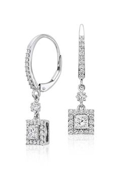 Elegant in design, these 1 ct. drop earrings feature shimmering princess diamonds accented by a halo of round diamonds.