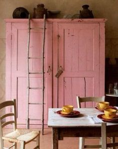 Old armoire painted my favorite color. Love the primitive ladder.