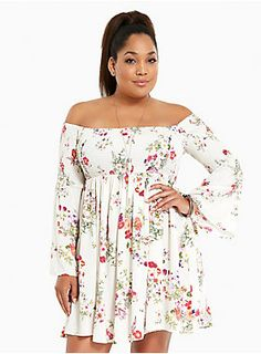 This ivory challis dress sports a gorgeous multi-color floral print that any flower child can appreciate. The smocked bodice is boho babe all grown up with bell sleeves (yet gives you the option to wear low off the shoulders). Go ahead, do a twirl girl!