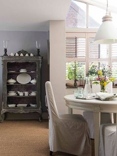 small dining table in garden room in 16th-century home