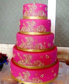 Hot pink and glorious gold make for one bold and beautiful cake at this @Mandy Dewey Seasons Hotel Seattle Indian wedding. @Devika Nambiar