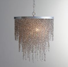 RH TEEN's Athena Crystal Chandelier Smoke:Our Athena Crystal Chandelier adds unabashed drama to any room. Its opulent, tiered design sparkles with dripping strands of elegant crystal beads.