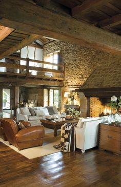 Living room for my mountain lodge. Minus the white couches. Can you believe the size of the fireplace? I could turn that into another room!